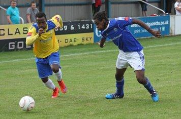 Enfield's Bobby Devyne (L) and Billericay's Alex Stephenson