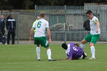 Enfield's Dernell Wynter (9) challenges Jason Prior as Chad Field looks on