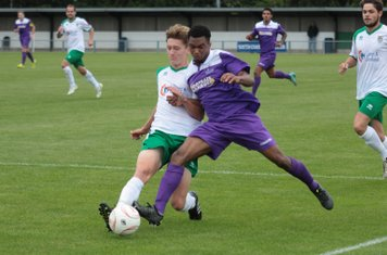 Bognor's Chad Field (L) wins a challenge with Dernell Wynter to clear for a corner