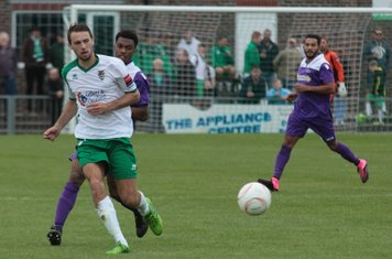 Bognor's Daryl Wollers (white/green) challenged by Dernell Wynter