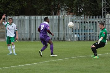 Bobby Devyne nonchalantly lifts the  ball over Grant Smith to give Enfield the lead.