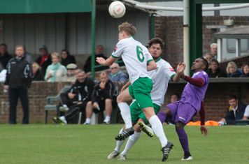 Bognor's Chad Field (6) heads clear from Bobby Devyne
