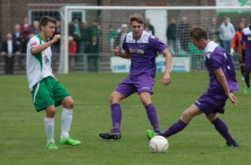 Bognor's Ollie Pearce (L) and Enfield's Connor Witherspoon and Mickey Parcell (R)