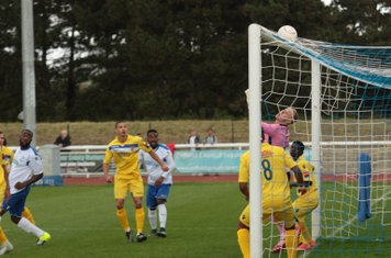 Harold Joseph (white shirt, L) watches his header graze the top of the Staines crossbar