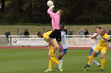 Staines keeper Jack Turner punches clear