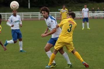 Enfield's Harry Ottaway (white shirt) and Staines's Jack Bennett