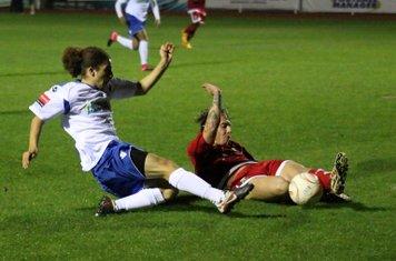 Hendon's Oliver Sprague (red) slides in to block from Tayshan Hayden-Smith