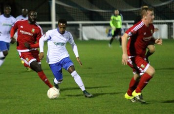 Enfield's Bobby Devyne runs between Mark Kirby (R) and Dave Diedhiou