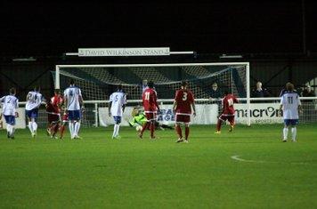 Enfield keeper Nathan McDonald saves Aaron Morgan's penalty
