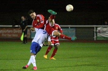 Hendon's Luke Tingey (red) mistimes a jump and lands on Corey Whitely