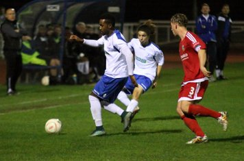 Enfield's Bobby Devyne (L) and Tayshan Hayden-Smith and Hendon's Oliver Sprague