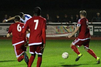 Enfield's Claudiu Vilcu sees his shot deflected by Mark Kirby