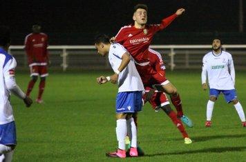 Hendon's Luke Tingey (red) challenges Corey Whitely