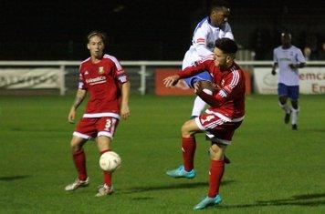 Hendon's Luke Tingey (red, R) challenges Bobby Devyne