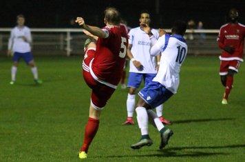 Hendon's Mark Kirby clears from Bobby Devyne