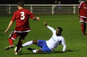 Enfield's Bobby Devyne (R) tackles Oliver Sprague