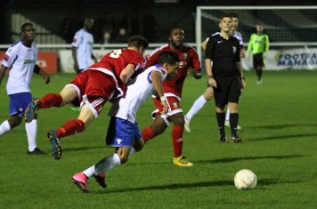 Hendon's Dean Cracknell (red) is penalised for a foul on Corey Whitely