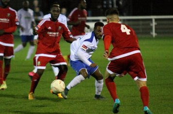 Hendon's Hassan Sulaiman and Luke Tingey (4) and Enfield's Bobby Devyne