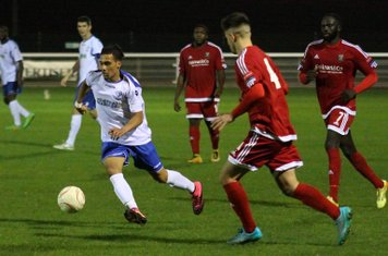 Enfield's Corey Whitely (L) and Hendon's Luke Tingey (4) and Dave Diedhiou