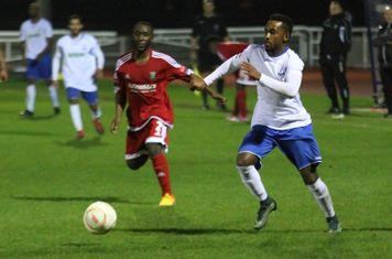 Enfield's Bobby Devyne (R) and Hendon's Hassan Sulaiman