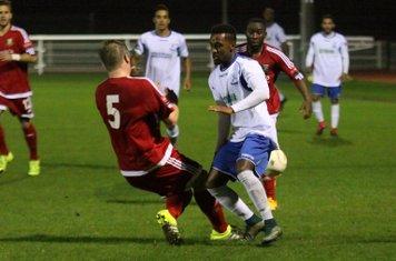 Hendon's Mark Kirby (5) tackles Bobby Devyne