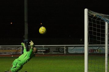 Wingate's Bobby Smith makes an excellent early save from Vance Bola's header