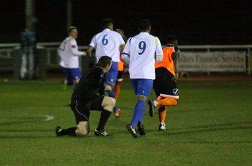 Referee Paul Forrester picks himself up after a collision with Enfield's Jandir da Cruz (6)