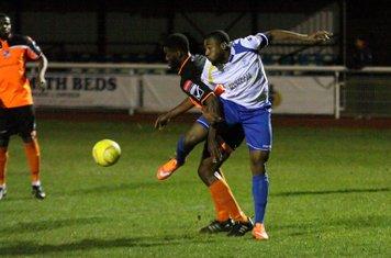 Enfield's Vance Bola (R) challenges Ola Sogbanmu