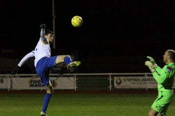 Enfield's Claudiu Vilcu tries to lift the ball over Bobby Smith