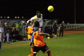 Enfield's Evams Kouassi wins a header