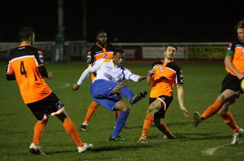Enfield's Vance Bola gets his shot away despite the efforts of (L-R) Ahmet Rifat, Daniel Brown, Mark Goodman and Marc Weatherstone