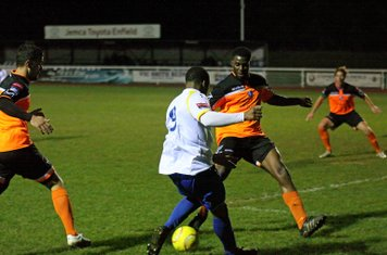 Enfield's Vance Bola (9) challenged by Ola Sogbanmu