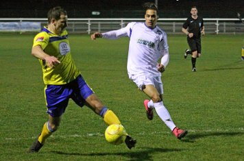 Kingstonian's  Bruce Hogg (L) and Enfield's Corey Whitely