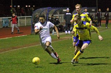 Enfield's Tyler Campbell and Kingstonian's George Wells (R) and Mitch Pinnock