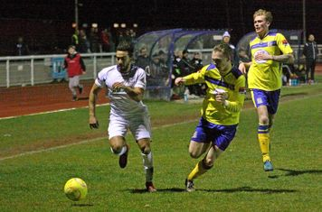Enfield's Tyler Campbell and Kingstonian's George Wells and Mitch Pinnock (R)