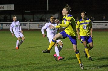 Kingstonian's George Wells heads clear