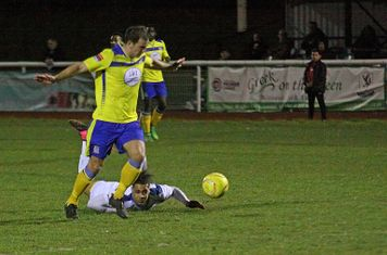 Kingstonian's Bruce Hogg (yellow) brings down Corey Whitely