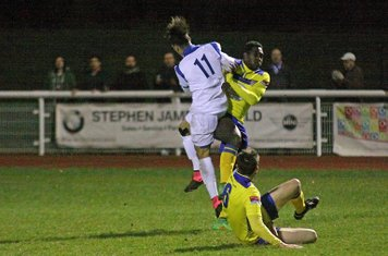 Enfield's Corey Whitely (11) challenges Aaron Goode as Alan Inns looks on