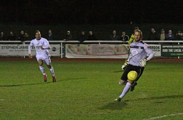 Kingstonian keeper Rob Tolfrey is nearly undone by a back-pass