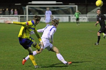 Kingstonian's George Wells (yellow) clears from Mickey Parcell