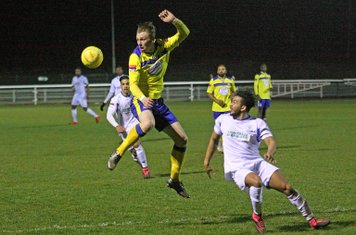 Kingstonian's George Wells (yellow) and Enfield's Tyler Campbell