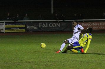 Enfield's Bobby Devyne is denied by an excellent tackle from Aaron Goode