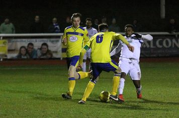 Kingstonian's Alan inns (6) tackles Bobby Devyne