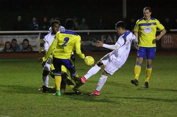 Kingstonian's Aaron Goode (2) clears from Corey Whitely
