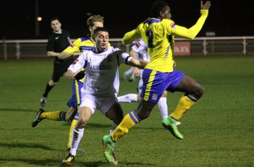 Kingstonian's Aaron Goode (R) clears from Samir Bihmoutine