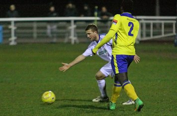 Enfield's Piotr Murawski (L) and Kingstonian's Aaron Goode