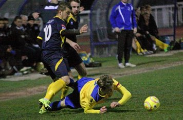 Enfield's Mickey Parcell (yellow) is brought down by Ollie Pearce (10)