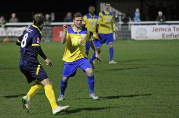 Enfield's Billy Crook (yellow) and Bognor's Dan Beck.