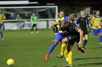 Bognor's Sami El-Abd (blue) tackles Bobby Devyne