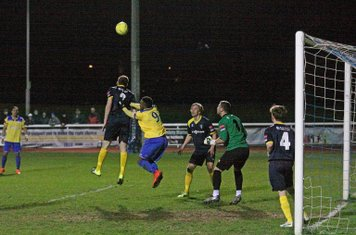 Bognor's Daryl Wollers (blue, L) heads clear but only as far as Corey Whitely (far L) who shot into the bottom corner for the first Enfield goal. If Doug Tuck (4) had stayed on the post rather than moving up he'd have cleared the shot without any difficul